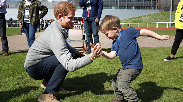 Prince Harry playing with a toddler