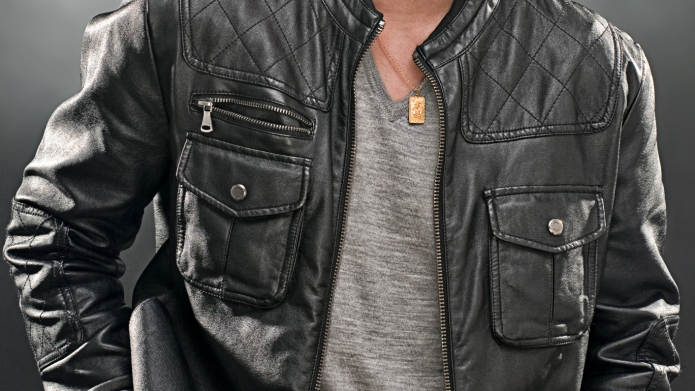 Asian male in leather jacket