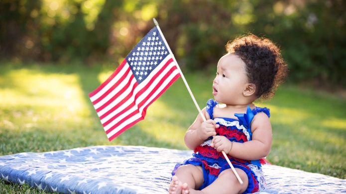 Baby Girl Looking At American Flag