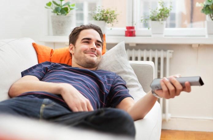 Man lying in sofa