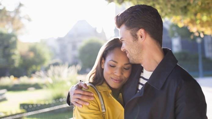 Couple hugging in urban park