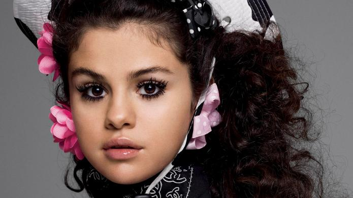 Selena Gomez poses topless and reveals