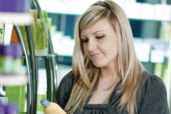 Woman reading cosmetics label