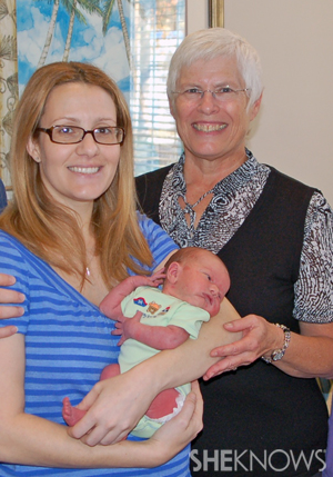 Rebecca Bahret with her midwife and baby