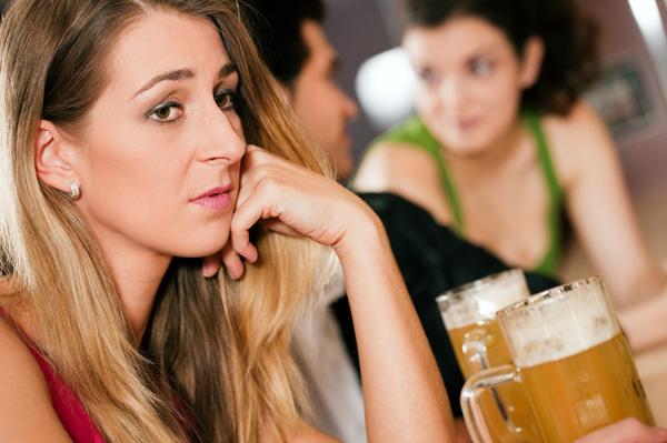 Rejected woman at bar