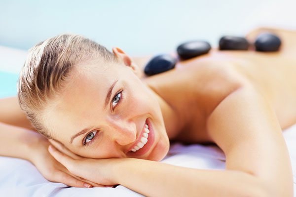 Relaxed woman getting stone therapy | Sheknows.com