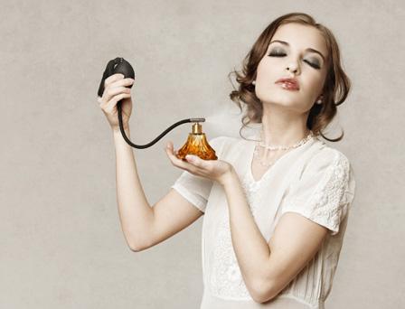 Sexy woman applying perfume
