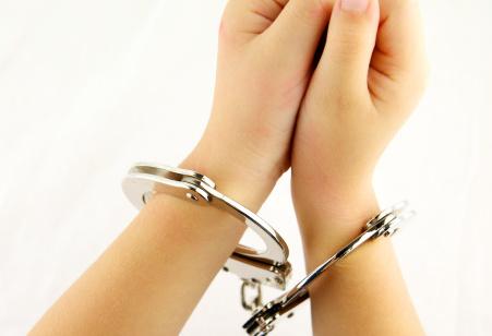 Child In Cuffs