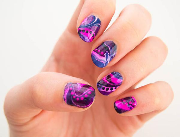 Marbled nail design with polka dots