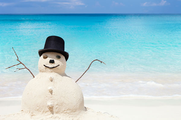 Sand snowman on the beach | Sheknows.com.au