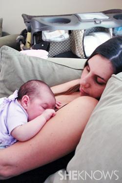 Sarah sleeping with her baby