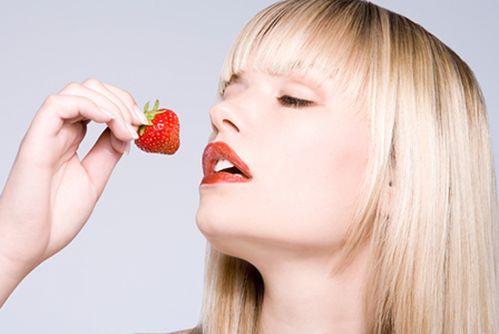 Sexy woman eating strawberry | Sheknows.ca