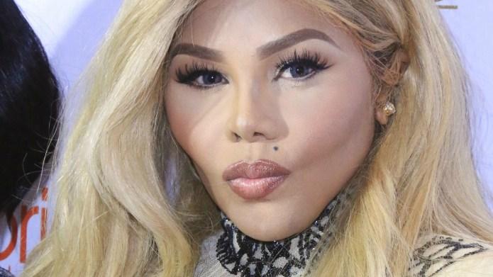Lil' Kim's dramatic new look is