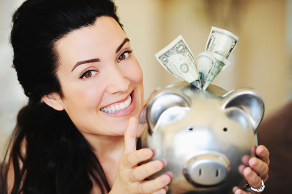 Smiling woman saving money