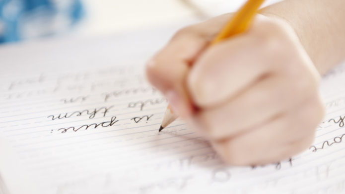 Close-up of girls hand writing on