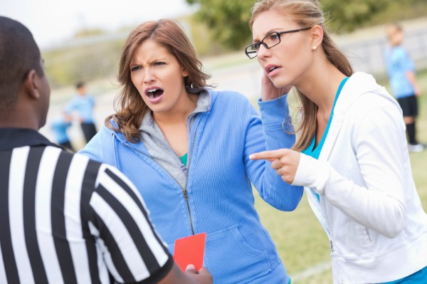 Soccer mom arguing with ref