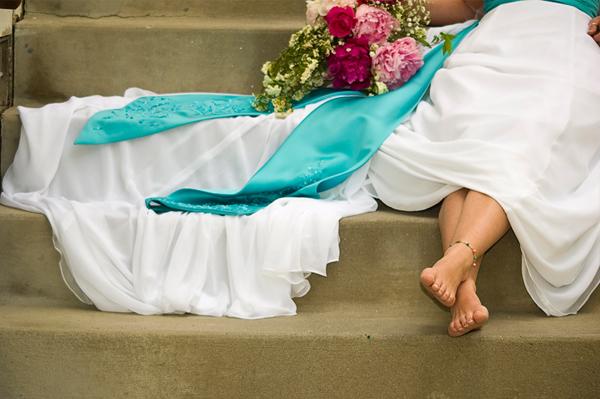 Blue sash on wedding dress