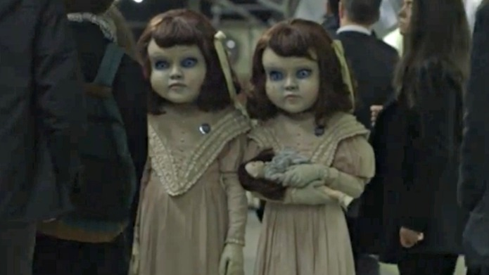 Two creepy life-size Victorian dolls are