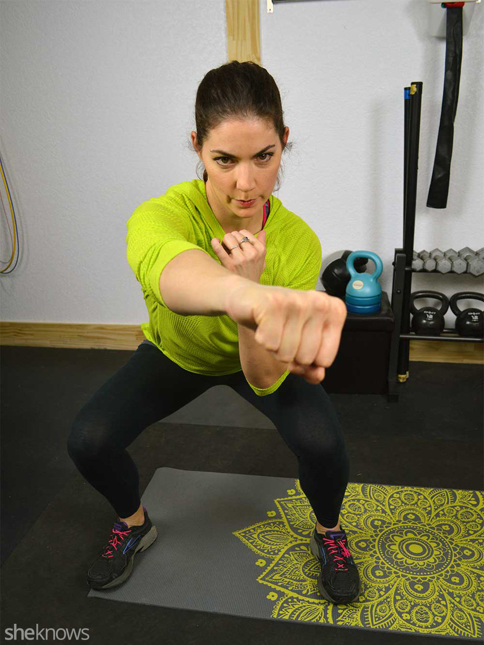 Low squat with alternating jabs