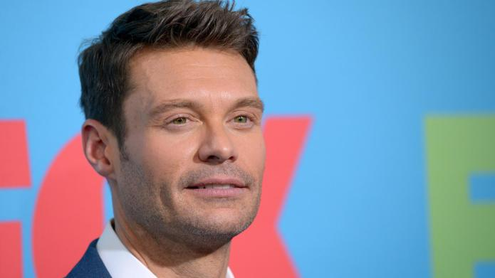 Ryan Seacrest having fun dating model