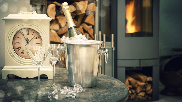 Clock, fireplace and champagne