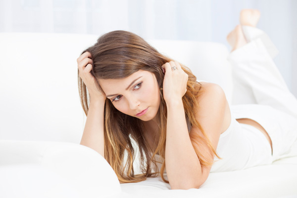 Stressed woman on bed