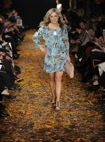 Audrey McClelland of in a floral patterned tunic dress from TJ Maxx that can flow from work to PTA meeting with ease.