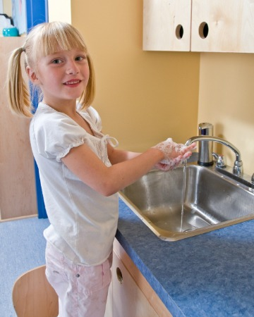 student washing hands