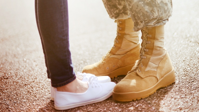 Young military couple kissing each other,