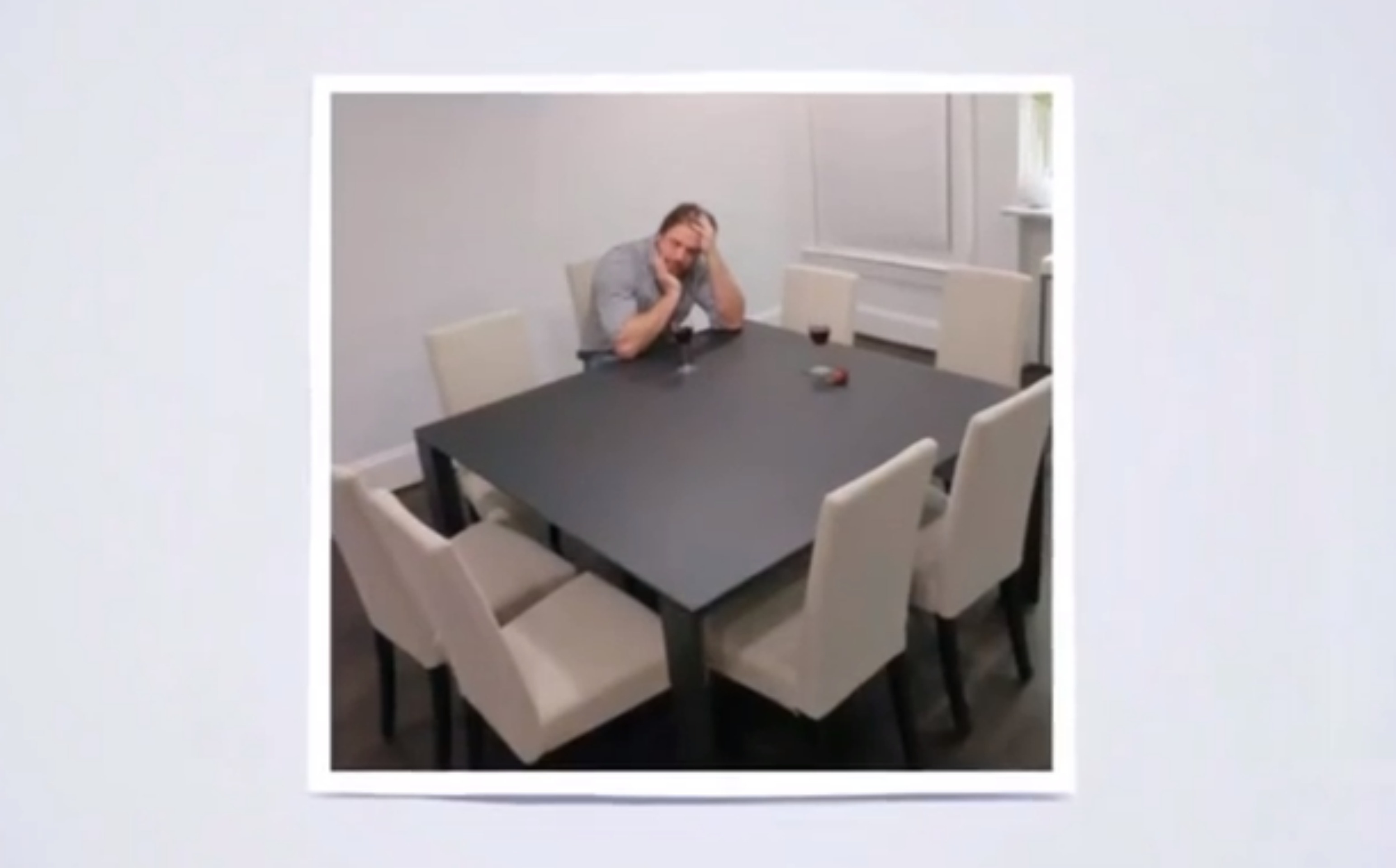 moping at a conference table