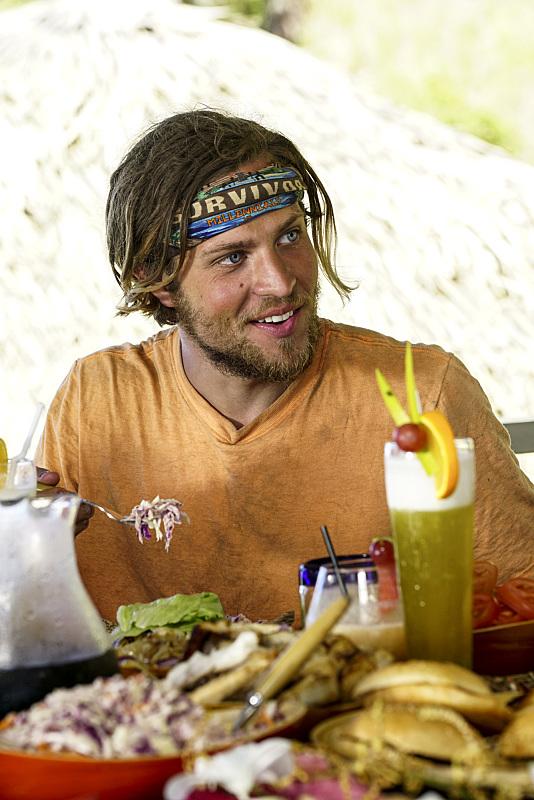 Taylor Stocker enjoys food Reward on Survivor: Millennials Vs. Gen-X