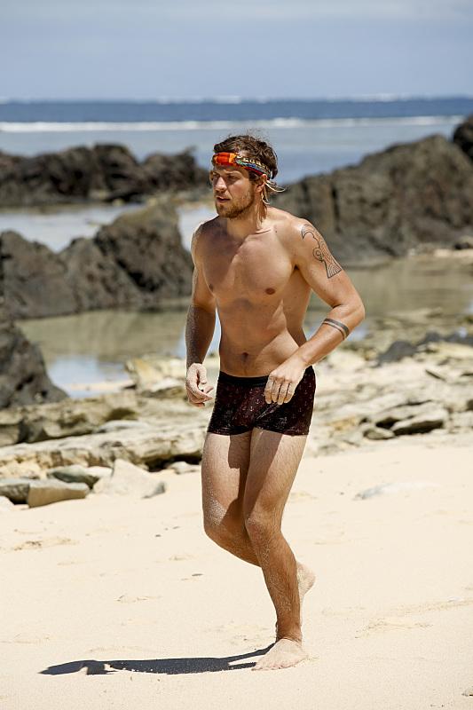 Taylor Stocker runs on beach during Survivor: Millennials Vs. Gen-X