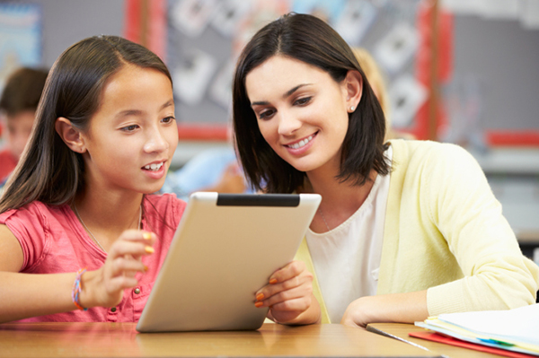 Teacher and student using tablet | Sheknows.com