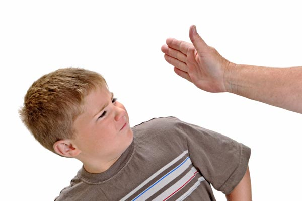 teacher raising hand to child to spank
