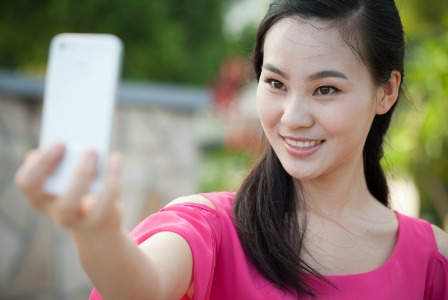 Teen taking a selfie