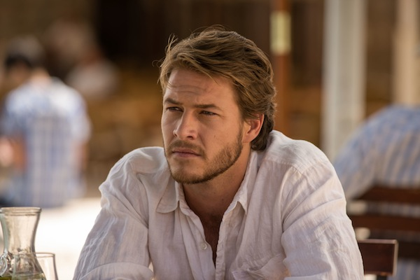 The November Man S Luke Bracey Leaves Pierce Brosnan In The Dust Sheknows