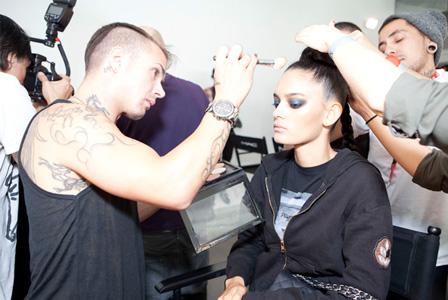 Model getting makeup done backstage