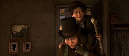 Gary Oldman carries Tiny Tim in A Christmas Carol