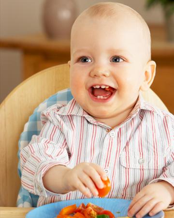 Toddler eating fruit and veggies