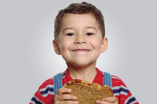 Toddler eating whole wheat