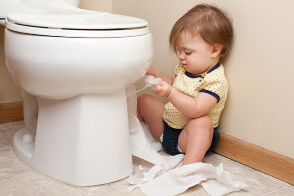 Toddler ripping up toilet paper in the bathroom | Sheknows.com