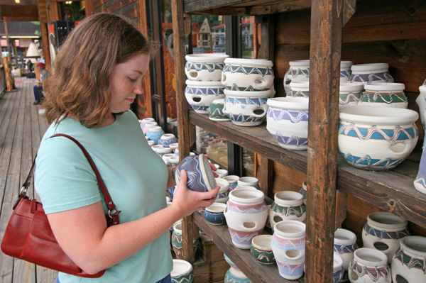 Tourist looking at pottery
