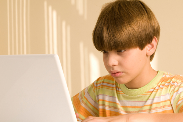 tween boy on laptop