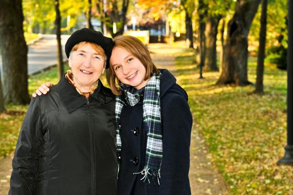 Tween taking walk with grandmother