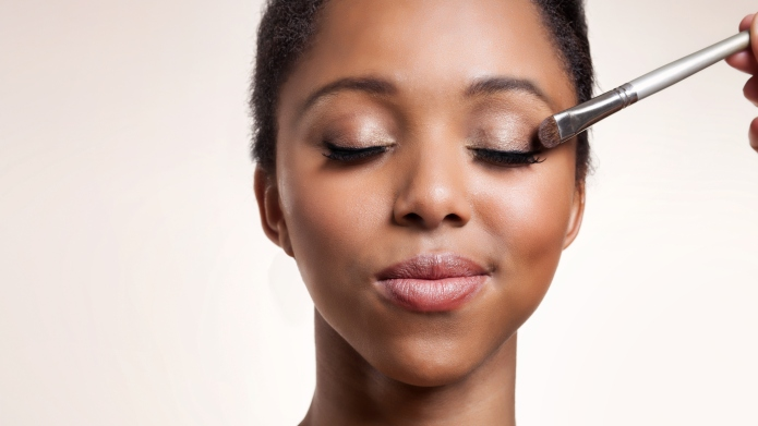 Woman having eyeshadow applied on her