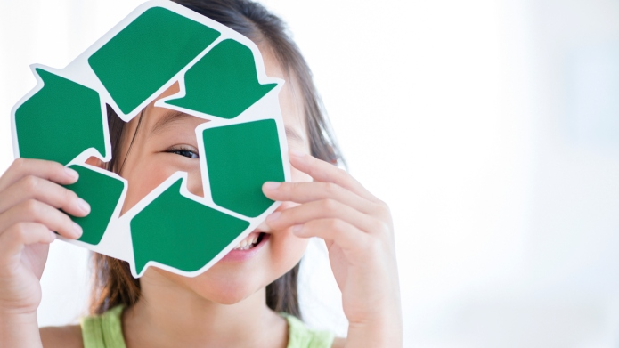 Korean girl holding recycle symbol