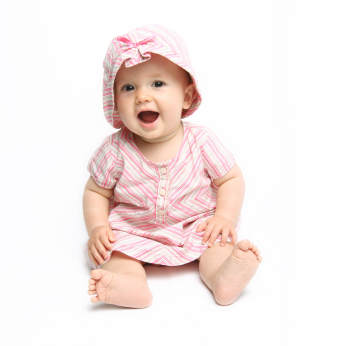 baby girl in pink dress