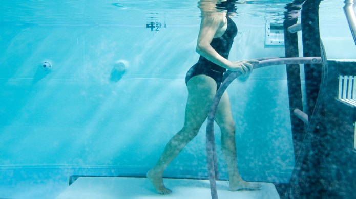 Woman walking on underwater treadmill in