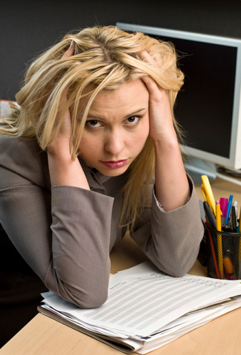 Unhappy woman at work