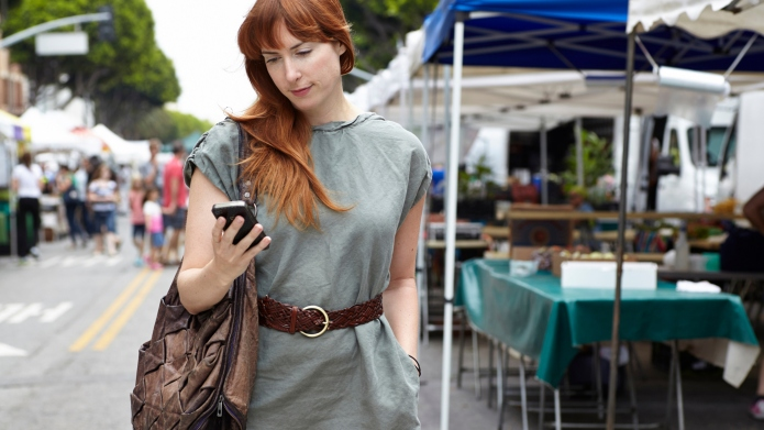 Mid adult woman looking at mobile